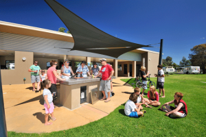 families enjoying caravan park bbq facilities